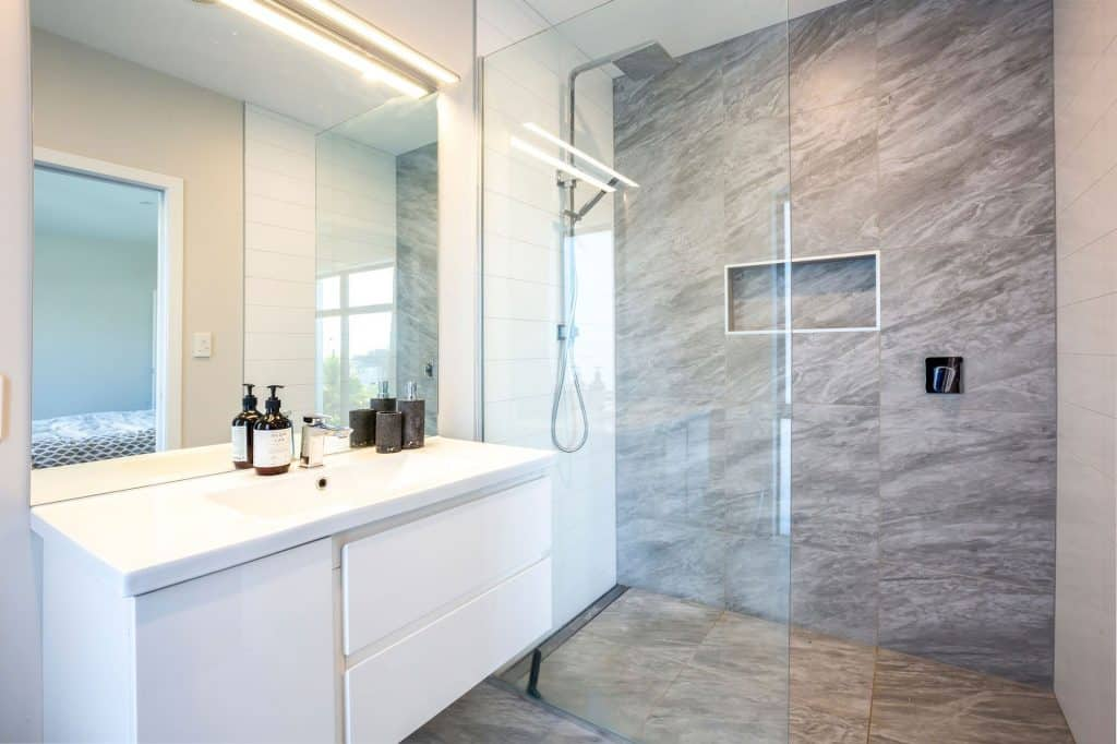 New Home Aotea - Grey and white bathroom, tiled shower feature panel
