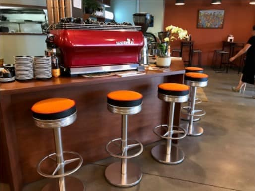 Café Petone – Faith & Co - Bright colours, green, orange, red, timber table tops